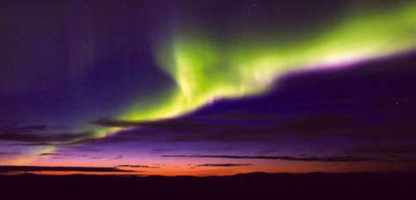 A panoromic view of northern lights from Alta in Norway