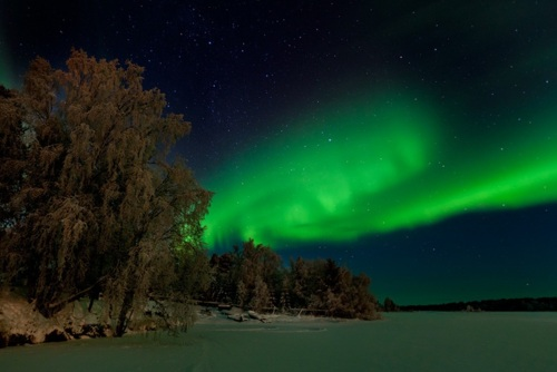 A panoromic view of northern lights from Lake-Inari in Finland