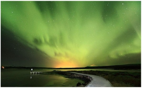 A panoromic view of northern lights from Ingvellir national park in Iceland